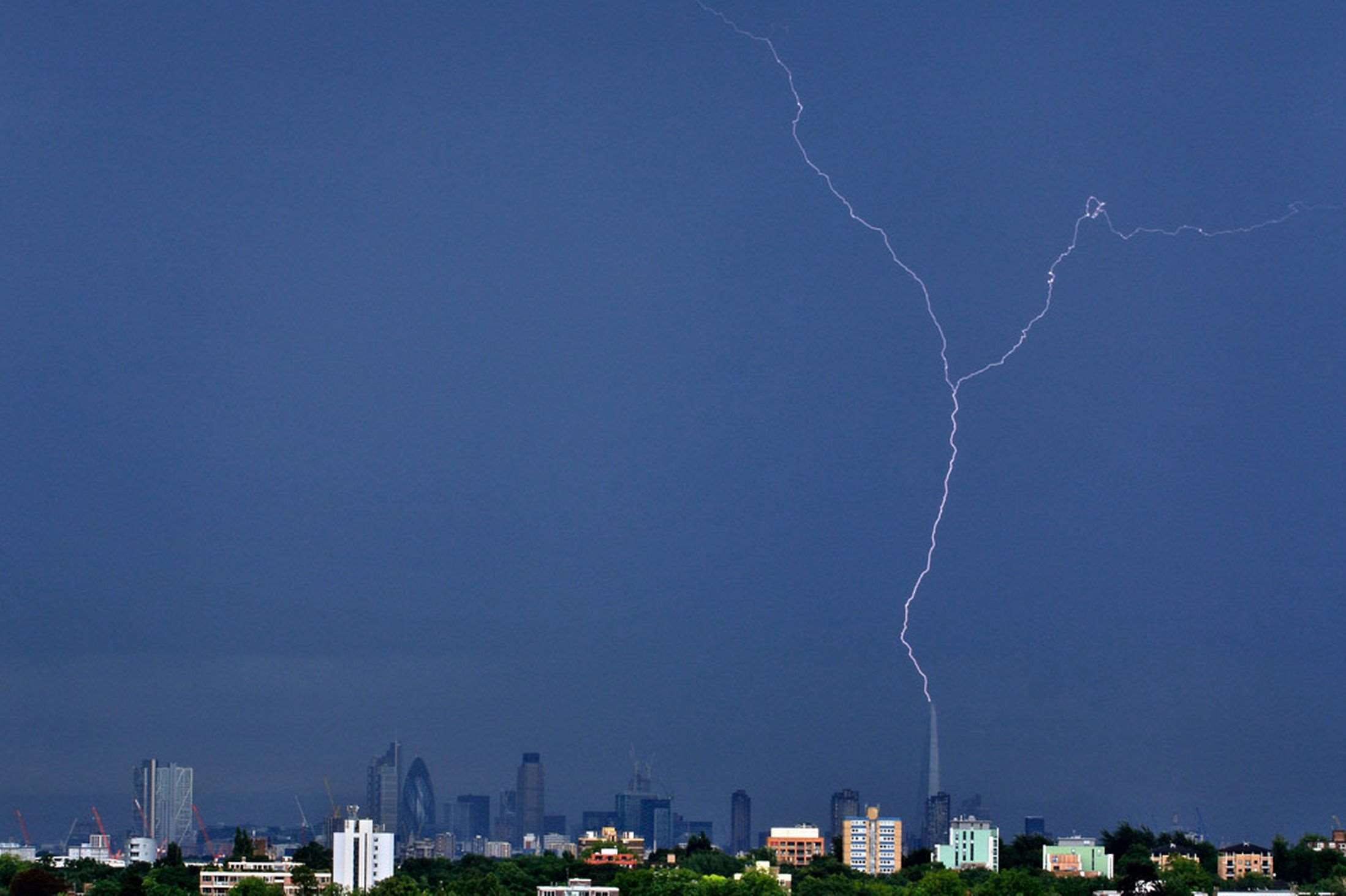 £££Fee for use Lightning strikes The Shard in London