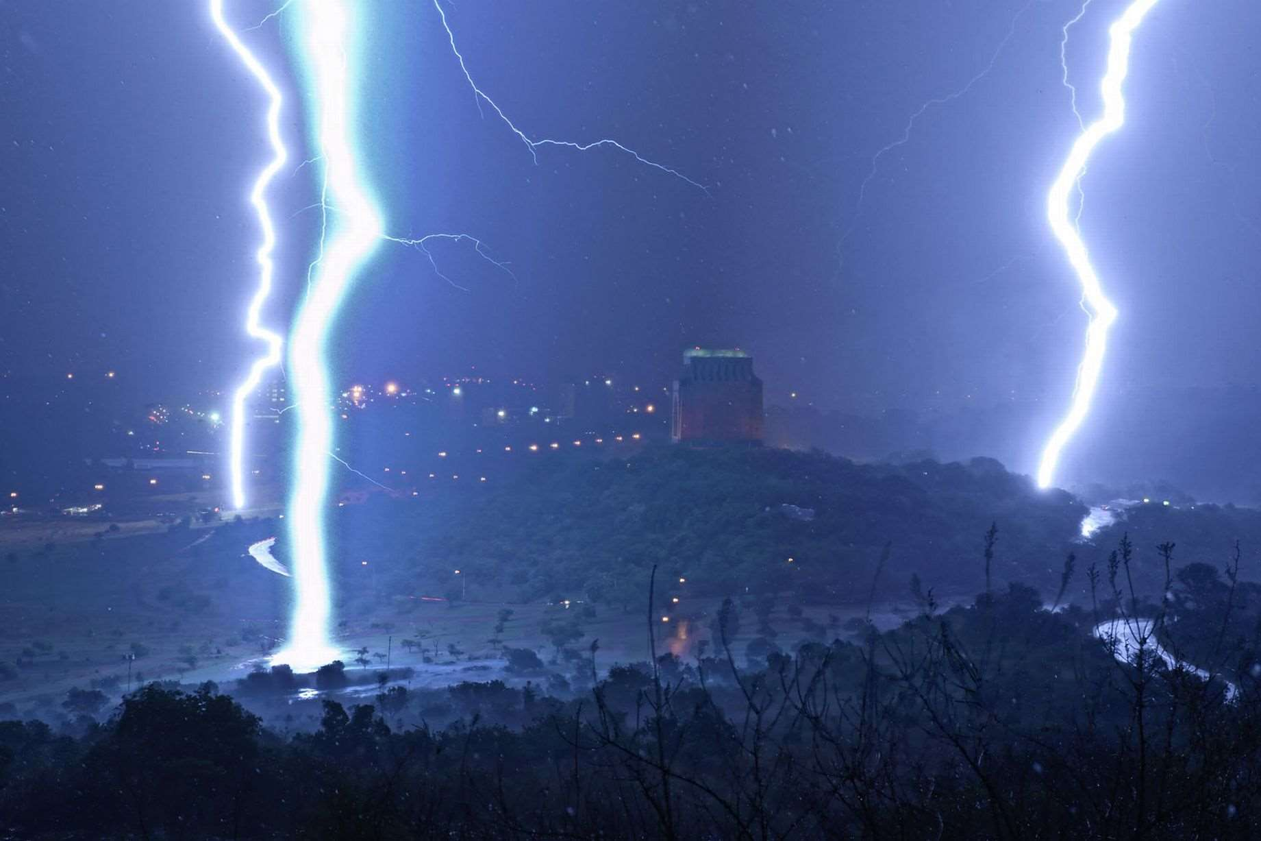 Monumental Chaos- The moment when 3 massive lightning strikes hit the earth within 15 seconds at Voortrekker Monument just outside Pretoria, South Africa
